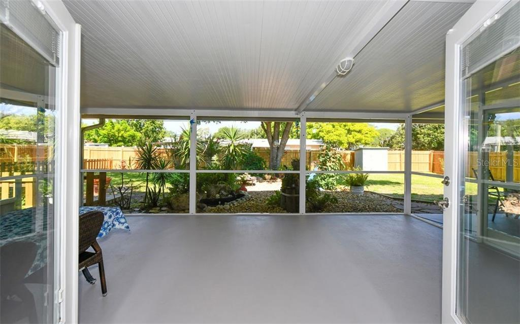 French doors open to the huge screened lanai. 20/20 screen keeps bugs out. - Single Family Home for sale at 120 23rd Street Ct Ne, Bradenton, FL 34208 - MLS Number is A4438232