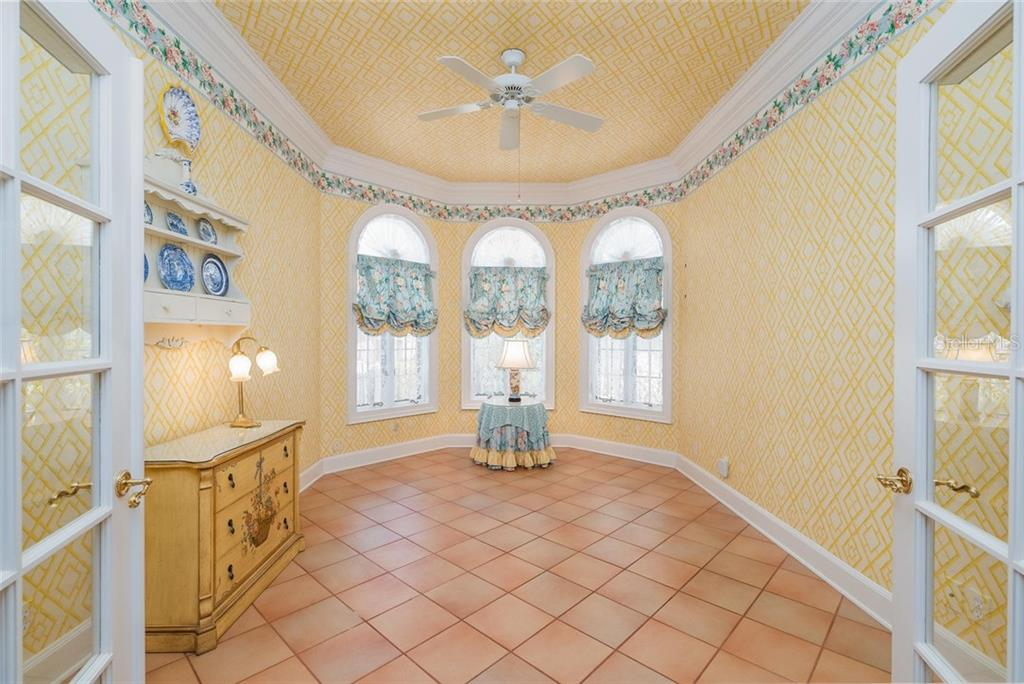 Charming BONUS ROOM with double glass panelled doors, high ceilings, intricate crown and base moldings, and views of the side garden and front entryway of detached guest home! - Single Family Home for sale at 3702 Beneva Oaks Blvd, Sarasota, FL 34238 - MLS Number is A4438878