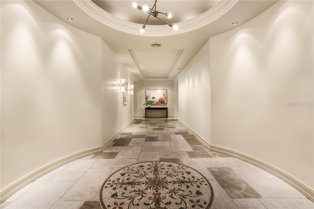 The gallery entrance is the perfect display space for an art collection. - Condo for sale at 1111 Ritz Carlton Dr #1704, Sarasota, FL 34236 - MLS Number is A4442192