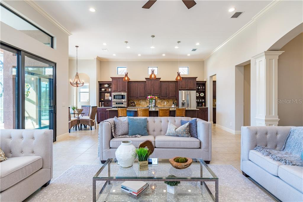 Dining Room - Single Family Home for sale at 14710 Leopard Creek Pl, Lakewood Ranch, FL 34202 - MLS Number is A4442202