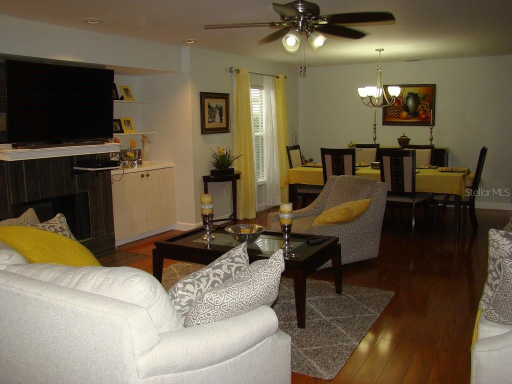 Living & Dining-Notice the woodburning fireplace - Villa for sale at 3008 Ringwood Mdw #5, Sarasota, FL 34235 - MLS Number is A4443322
