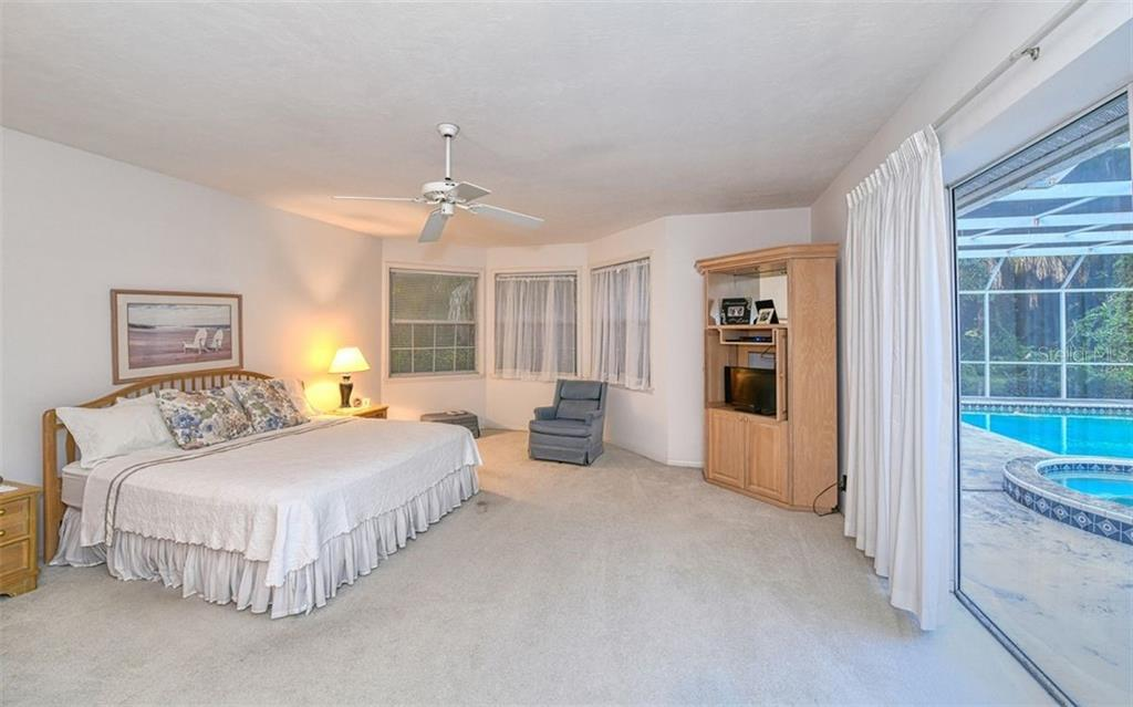 Large Master Bedroom opens to pool.  Large walk in closet - Single Family Home for sale at 2316 Nw 85th St Nw, Bradenton, FL 34209 - MLS Number is A4445702