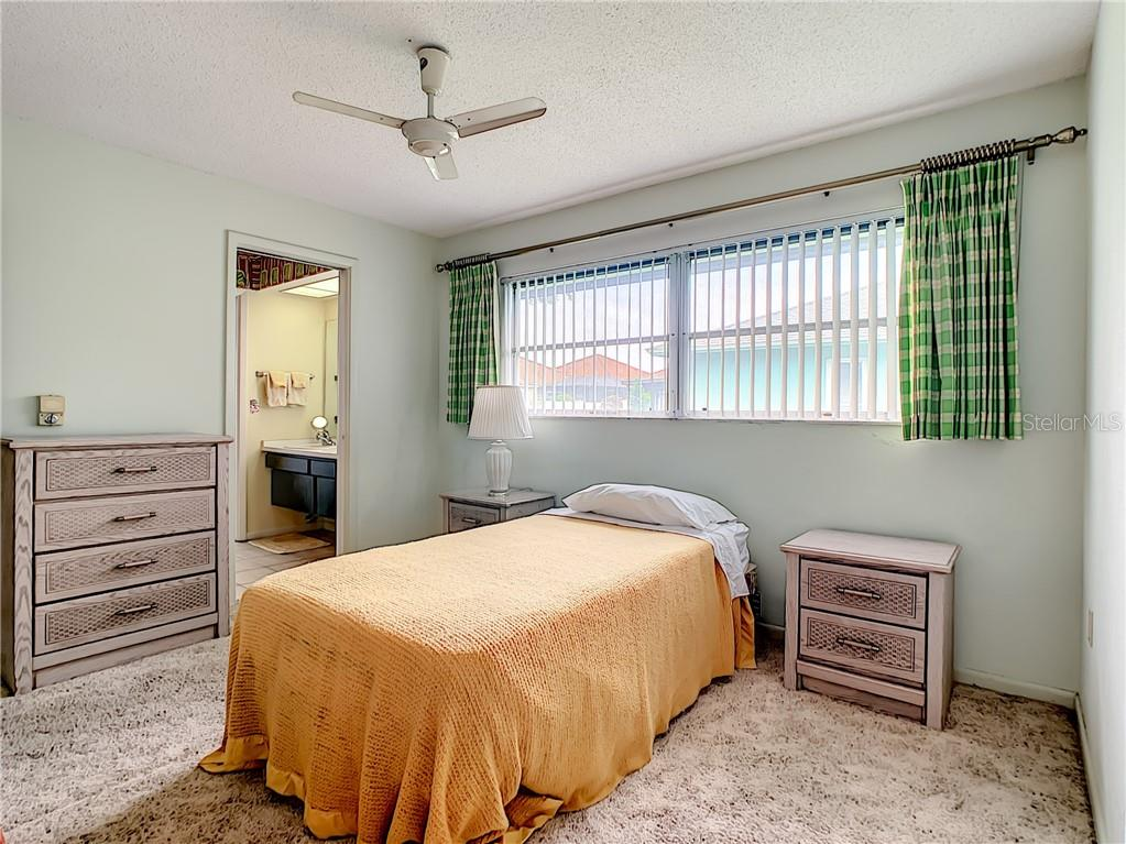 Bedroom 2 looking towards Jack & Jill bathroom. - Single Family Home for sale at 7006 18th Ave W, Bradenton, FL 34209 - MLS Number is A4450658