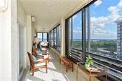 Massive Balcony on the South side. Views of the Bay and Gulf. Bedrooms and living room have sliding glass doors to the balcony - Condo for sale at 1100 Benjamin Franklin Dr #804, Sarasota, FL 34236 - MLS Number is A4172174