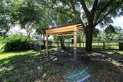 Gazebo and dog kennels. - Single Family Home for sale at 2045 Frederick Dr, Venice, FL 34292 - MLS Number is A4416740