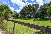 Private road that leads to the property. - Single Family Home for sale at 2045 Frederick Dr, Venice, FL 34292 - MLS Number is A4416740
