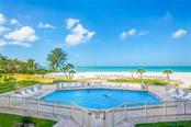 Pool and beach view - Condo for sale at 20 Whispering Sands Dr #102 & 103, Sarasota, FL 34242 - MLS Number is A4441587