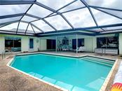 Refreshing 26x16 heated pool. - Single Family Home for sale at 7006 18th Ave W, Bradenton, FL 34209 - MLS Number is A4450658