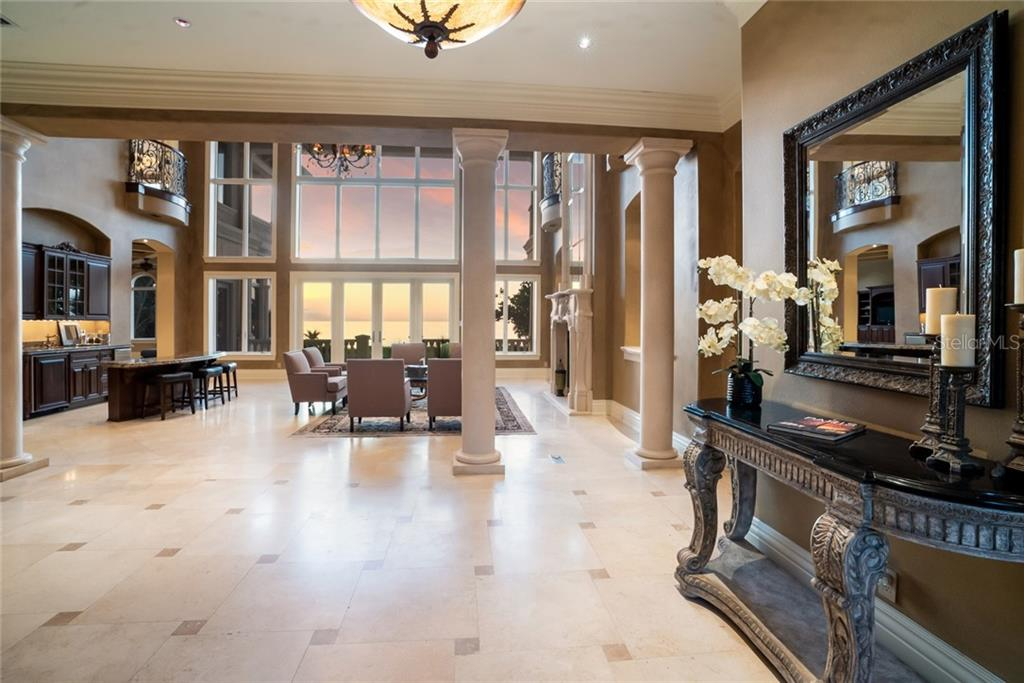 You and your guests we be welcomed through hand crafted mahogany doors and into the spacious foyer. - Single Family Home for sale at 507 Casey Key Rd, Nokomis, FL 34275 - MLS Number is N6102642