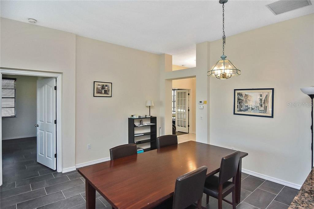 Dining area - Single Family Home for sale at 724 Silk Oak Dr, Venice, FL 34293 - MLS Number is N6102801