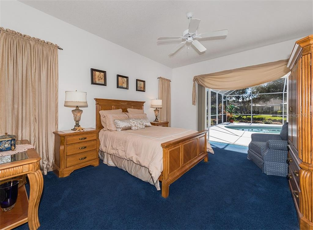 Master bedroom with sliders to pool - Single Family Home for sale at 2201 Sonoma Dr E, Nokomis, FL 34275 - MLS Number is N6103410