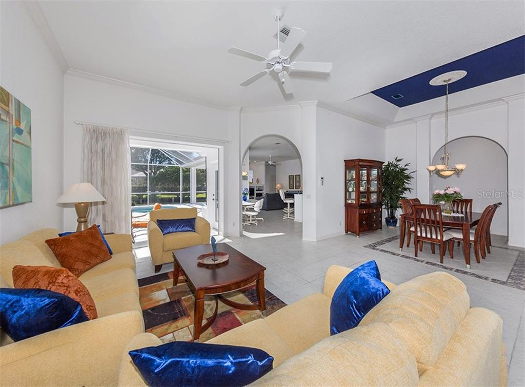 Living room, dining room - Single Family Home for sale at 2201 Sonoma Dr E, Nokomis, FL 34275 - MLS Number is N6103410