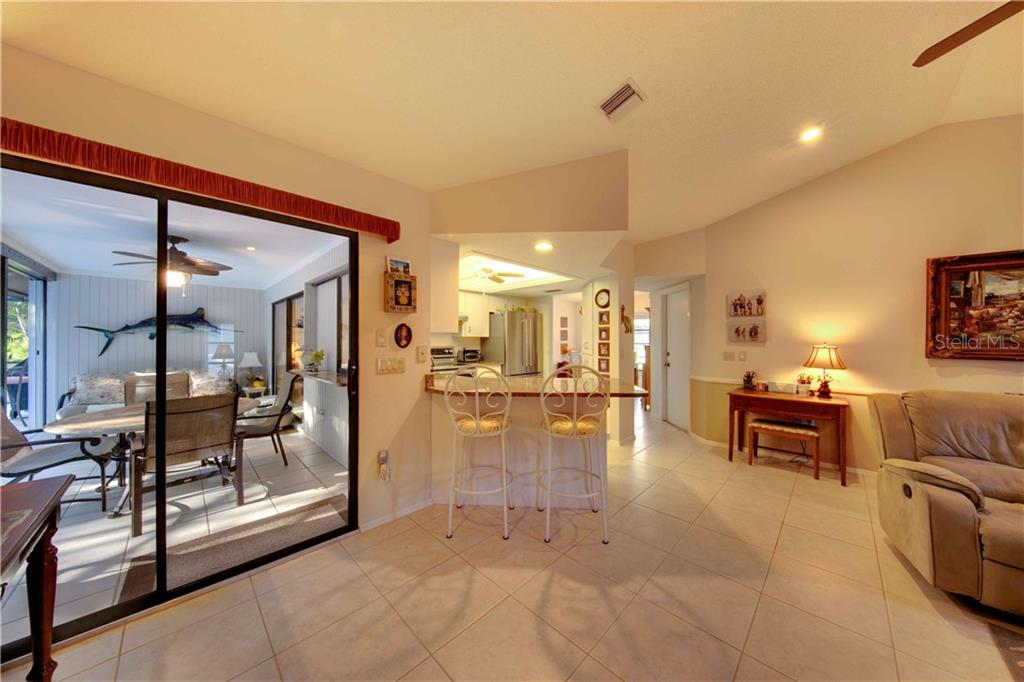 Can lights and sliding doors provide plenty of light - Single Family Home for sale at 506 Cedarwood Ln, Venice, FL 34293 - MLS Number is N6103905