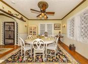 Dining Room in Main House with original wood floors - Single Family Home for sale at 309 Sorrento St, Venice, FL 34285 - MLS Number is N6104116